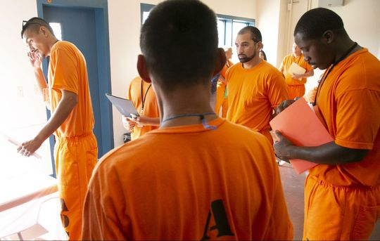 Inmates wait in line at a job fair at a Second Chance Center
