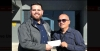 DOC Case Manager Tony De La Torre (right) presents Alex Aragon, Senior Community Development Manager with the American Cancer Society (ACS) (left) with a check for $5,870.26